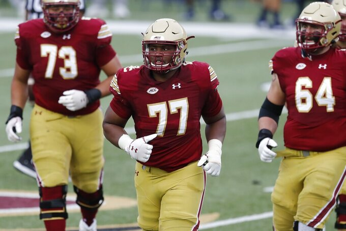 FILE - Boston College offensive lineman Zion Johnson (77) plays against Georgia Tech during the first half of an NCAA college football game in Boston, in this Saturday, Oct. 24, 2020, file photo. Johnson was selected to The Associated Press Preseason All-America first team offense, Monday Aug. 23, 2021. (AP Photo/Michael Dwyer, File)