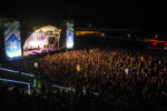 People attend the Cruilla music festival in Barcelona, Spain, Friday, July 9, 2021. (AP Photo/Joan Mateu)