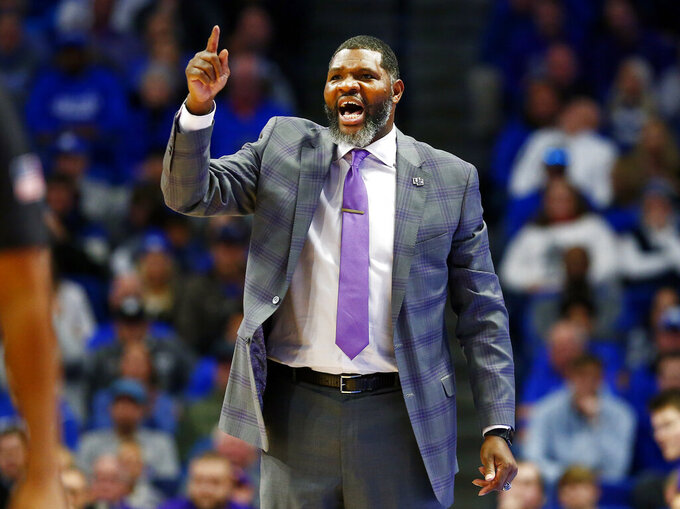 Evansville coach Walter McCarty shouts during the second half of the team's NCAA college basketball game against Kentucky in Lexington, Ky., Tuesday, Nov. 12, 2019. Evansville won 67-64. (AP Photo/James Crisp)