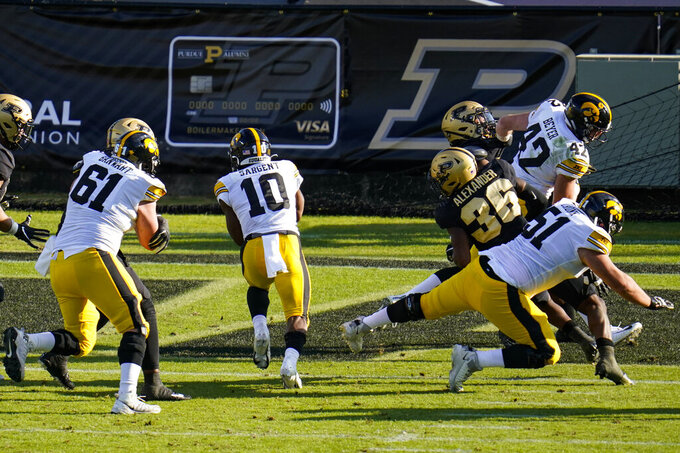 Iowa running back Mekhi Sargent (10) runs in for a touchdown against Purdue during the second quarter of an NCAA college football game in West Lafayette, Ind., Saturday, Oct. 24, 2020. (AP Photo/Michael Conroy)