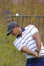 Team USA's Brooks Koepka chips to a practice green during a practice day at the Ryder Cup at the Whistling Straits Golf Course Tuesday, Sept. 21, 2021, in Sheboygan, Wis. (AP Photo/Jeff Roberson)