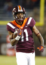 Virginia Tech wide receiver Tre Turner (11) heads to the end zone for a score during the first half of an NCAA college football game against Georgia Tech in Blacksburg, Va., Thursday, Oct. 25, 2018. (AP Photo/Steve Helber)