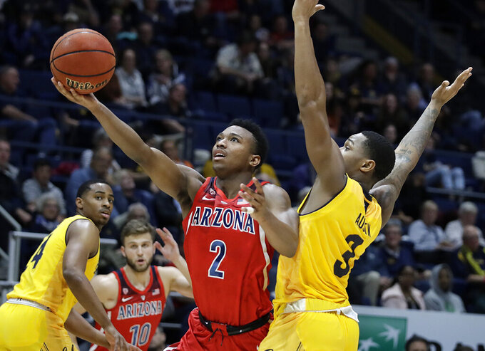 Arizona's Brandon Williams (2) lays up a shot past California's Paris Austin, right, during the second half of an NCAA college basketball game Saturday, Jan. 12, 2019, in Berkeley, Calif. (AP Photo/Ben Margot)