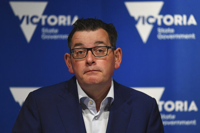 """Victorian State Premier Daniel Andrews addresses a press conference in Melbourne, Australia, Tuesday, June 23, 2020. Two schools have been closed in Melbourne after students tested positive for the coronavirus. Victoria state has recorded 17 new cases and Andrews said there would be """"significant community transmission"""" among the new cases. (James Ross/AAP Image via AP)"""