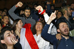 Protesters chant slogans, during ongoing protests against the Lebanese government, in front of the Central Bank, in Beirut, Lebanon, Thursday, Nov. 28, 2019. Lebanon paid back a Eurobond worth $1.5 billion that was scheduled to mature Thursday, a Finance Ministry official said, pacifying concerns of a first-ever default on its debt amid the worst financial crisis in three decades. (AP Photo/Bilal Hussein)