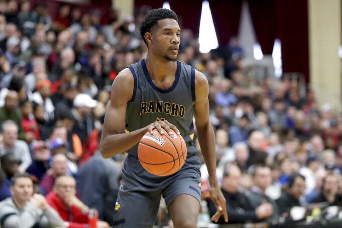 FILE - In this Jan. 20, 2020, file photo, Rancho Christian's Evan Mobley controls the ball against DeMatha during a high school basketball game at the Hoophall Classic in Springfield, Mass. Among the slew of new players on Southern California's roster, Mobley stands out. He joins the Trojans as one of the nation's most hyped freshmen and figures to make an immediate impact on a team seeking a breakthrough. (AP Photo/Gregory Payan, File)
