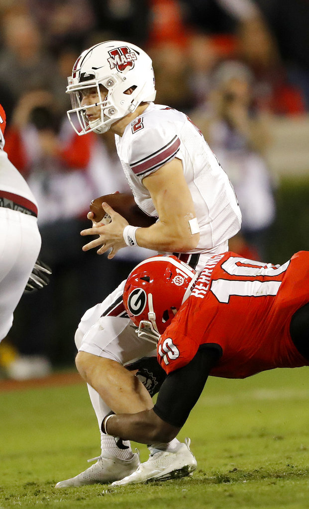 Massachusetts quarterback Ross Comis (2) is sacked by Georgia defensive lineman Malik Herring (10) during the second half of an NCAA college football game Saturday, Nov. 17, 2018, in Athens, Ga. (AP Photo/John Bazemore)