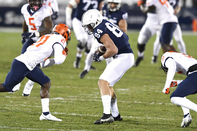 Penn State tight end Theo Johnson (84) catches a pass in front of Illinois defensive back Jartavius Martin (21) during the first quarter of an NCAA college football game in State College, Pa., on Saturday, Dec. 19, 2020. (AP Photo/Barry Reeger)