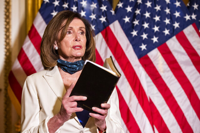 House Speaker Nancy Pelosi of Calif., reading from the Bible, reacts to President Donald Trump during a news conference at the U.S. Capitol in Washington, Tuesday, June 2, 2020. (AP Photo/Manuel Balce Ceneta)