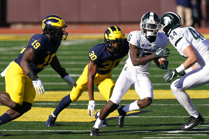 Michigan State wide receiver Jayden Reed (5) rushes against the Michigan defense during the second half of an NCAA college football game, Saturday, Oct. 31, 2020, in Ann Arbor, Mich. (AP Photo/Carlos Osorio)