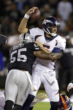 Denver Broncos quarterback Joe Flacco is tackled by Oakland Raiders outside linebacker Vontaze Burfict (55) during the first half of an NFL football game Monday, Sept. 9, 2019, in Oakland, Calif. (AP Photo/Ben Margot)