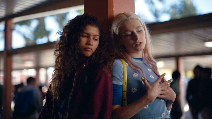 """This image released by HBO shows Zendaya, left, and Hunter Schafer in a scene from the series """"Euphoria."""" LGBTQ and gender inclusiveness on television has retreated slightly this season due to delays and shutdowns cased by the COVID-19 pandemic, according to a new study out Thursday by the advocacy group GLAAD. There were also declines in LGBTQ representation on streaming services and prime-time scripted cable shows, triggered in part by production shutdowns of such series as """"The L Word,"""" """"Euphoria"""" and """"Killing Eve."""" (HBO via AP)"""