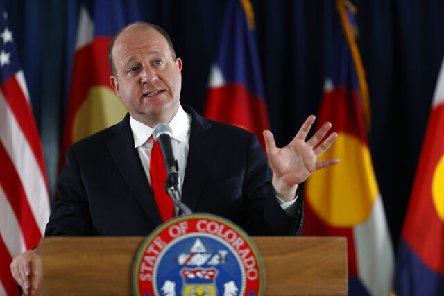 FILE - In this June 15, 2020, file photo, Colorado Gov. Jared Polis makes a point during a news conference in Denver. Gov. Polis has ordered a task force to assess initial damage and recommend mitigation measures for severe drought conditions affecting 40 of Colorado's 64 counties, or roughly a third of the state. Polis' order follows dwindling mountain snowpack, a warmer-than-average spring and far less precipitation than normal, Colorado Politics reported Wednesday, June 24, 2020. (AP Photo/David Zalubowski, File)