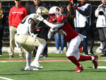 Wake Forest's Steven Claude (88) attempts to tackle Louisville running back Hassan Hall (19) during the first half of an NCAA college football game, Saturday, Oct. 27, 2018, in Louisville, Ky. (AP Photo/Timothy D. Easley)