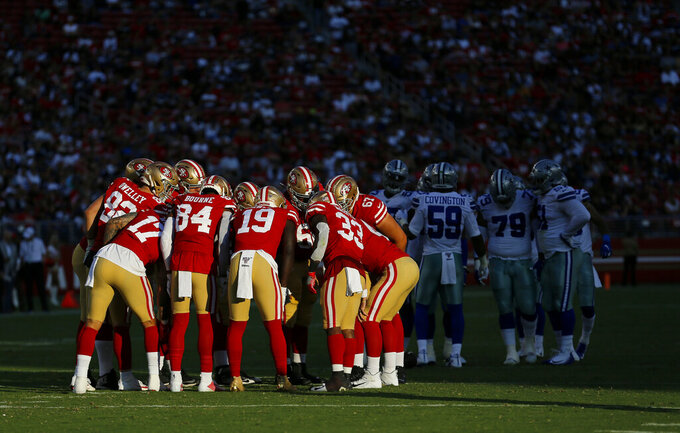 San Francisco 49ers offensive players huddle during the first half of the team's NFL preseason football game against the Dallas Cowboys in Santa Clara, Calif., Saturday, Aug. 10, 2019. (AP Photo/Josie Lepe)