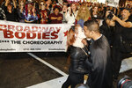 A couple kisses after getting engaged during the Greenwich Village Halloween Parade, Thursday, Oct. 31, 2019, in New York. (AP Photo/Frank Franklin II)