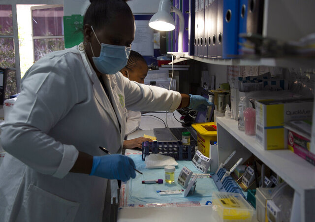 Laboratory technicians test a blood sample for HIV infection at the Reproductive Health and HIV Institute (RHI) in Johannesburg, Thursday, Nov. 26 2020. The successful trials of a new injectable drug that needs to be taken every eight weeks to prevent HIV infection is being lauded on World AIDS Day as a turning point for the fight against a global health threat that's been eclipsed by the coronavirus pandemic. (AP Photo/Denis Farrell)