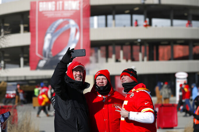 Fans take a selfie outside Arrowhead Stadium before the NFL AFC Championship football game between the Kansas City Chiefs and the Tennessee Titans Sunday, Jan. 19, 2020, in Kansas City, MO. (AP Photo/Jeff Roberson)