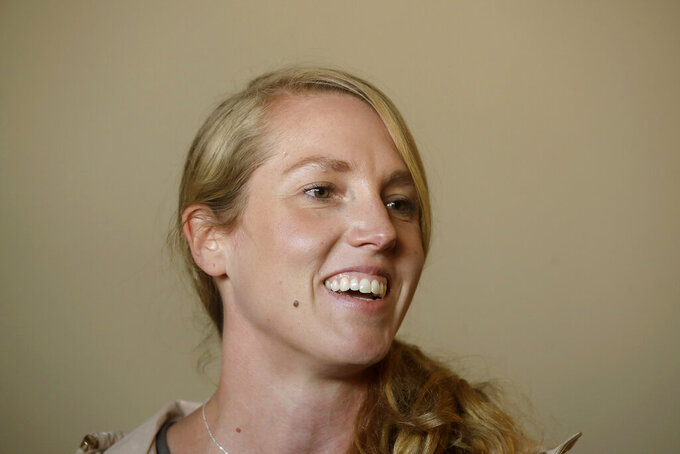 San Francisco Giants coach Alyssa Nakken smiles while speaking to reporters at Oracle Park in San Francisco, Thursday, Feb. 6, 2020. Nakken is the first female coach on a major league staff in baseball p. (AP Photo/Jeff Chiu)