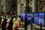 Cardinals who could not preside due to COVID-19 attends via video connection a consistory ceremony where 13 bishops were elevated to a cardinal's rank in St. Peter's Basilica at the Vatican, Saturday, Nov. 28, 2020. (Fabio Frustaci/POOL via AP)