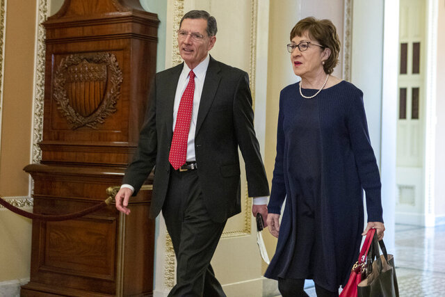 Sen. John Barrasso, R-Wyo., left, and Sen. Susan Collins, R-Maine, walk to the Senate chamber for the impeachment trial of President Donald Trump at the Capitol, Friday, Jan. 24, 2020, in Washington. (AP Photo/Steve Helber)