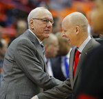 Syracuse head coach Jim Boeheim, left, and Louisville head coach Chris Mack, right, meet before the start of an NCAA college basketball game in Syracuse, N.Y., Wednesday, Feb. 20, 2019. (AP Photo/Nick Lisi)
