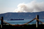 Seen from Alameda, Calif., a grass fire burns in South San Francisco on Friday, Oct. 16, 2020. Portions of Northern California remain under red flag fire warnings due to high temperatures and dry winds. (AP Photo/Noah Berger)