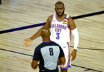Oklahoma City Thunder's Chris Paul (3) discusses a call with referee Marc Davis (8) during the first half of an NBA basketball game against the Oklahoma City Thunder' Wednesday, Aug. 5, 2020, in Lake Buena Vista, Fla. (Kevin C. Cox/Pool Photo via AP)
