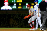 St. Louis Cardinals' Harrison Bader, third from right, reacts after hitting an RBI-double as Chicago Cubs second baseman Ben Zobrist, second from right, looks on during the sixth inning of a baseball game Thursday, Sept. 19, 2019, in Chicago. (AP Photo/Matt Marton)