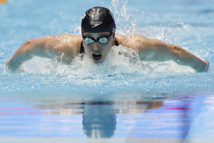 FILE - In this July 24, 2019, file photo, Hali Flickinger swims in the women's 200m butterfly semifinal at the World Swimming Championships in Gwangju, South Korea. With sports still largely on hold because of the coronavirus outbreak, some athletes and coaches have taken advantage of the unexpected free time to try new things, or maybe brush up on an old hobby. For Olympic swimmer Hali Flickinger, it's gardening and home renovations. (AP Photo/Lee Jin-man, File)
