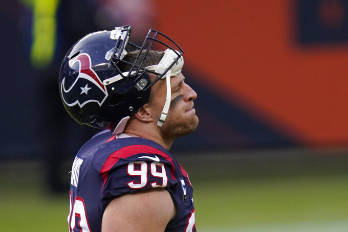Houston Texans' J.J. Watt walks off the field following an NFL football game against the Chicago Bears, Sunday, Dec. 13, 2020, in Chicago. (AP Photo/Charles Rex Arbogast)