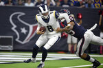 Los Angeles Rams quarterback Brandon Allen (8) breaks away from Houston Texans linebacker Jamal Davis II (49) during the first half of a preseason NFL football game Thursday, Aug. 29, 2019, in Houston. (AP Photo/Eric Christian Smith)