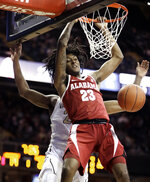 Alabama guard John Petty dunks the ball against Vanderbilt in the first half of an NCAA college basketball game, Saturday, Feb. 9, 2019, in Nashville, Tenn. (AP Photo/Mark Humphrey)