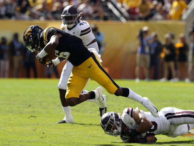 Iowa wide receiver Ihmir Smith-Marsette (6) gets tripped up by Mississippi State safety Johnathan Abram (38) during the first half of the Outback Bowl NCAA college football game, Tuesday, Jan. 1, 2019, in Tampa, Fla. (AP Photo/Chris O'Meara)