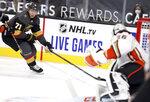 Vegas Golden Knights center William Karlsson (71) moves in on Anaheim Ducks goalie John Gibson (36) during the second period of an NHL hockey game Thursday, Jan. 14, 2021, in Las Vegas. (AP Photo/Isaac Brekken)