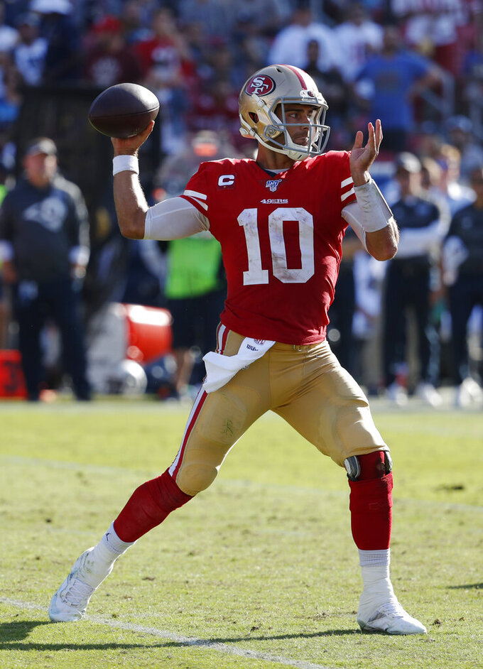 San Francisco 49ers quarterback Jimmy Garoppolo throws against the Los Angeles Rams during the second half of an NFL football game Sunday, Oct. 13, 2019, in Los Angeles. (AP Photo/John Locher )