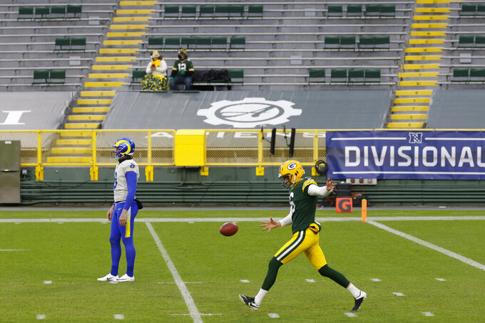 Green Bay Packers punter J.K. Scott, right, and Los Angeles Rams punter Johnny Hekker warm up before an NFL divisional playoff football game, Saturday, Jan. 16, 2021, in Green Bay, Wis. (AP Photo/Matt Ludtke)