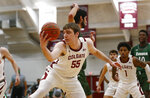 Colgate's Jeff Woodward (55) grabs a rebound against Loyola (Md.) during an NCAA college basketball game in the finals of the Patriot League tournament, Sunday, March 14, 2021, in Hamilton, N.Y. (AP Photo/John Munson)