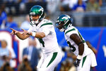 FILE - In this Aug. 9, 2019, file photo, New York Jets quarterback Sam Darnold calls out to teammates as running back Ty Montgomery stands nearby during the first half of the team's preseason NFL football game against the New York Giants in East Rutherford, N.J. Darnold has built off a solid finish to his rookie season with a terrific camp and preseason. (AP Photo/Adam Hunger, File)