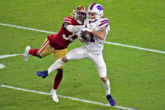 Buffalo Bills wide receiver Cole Beasley (11) makes the catch as San Francisco 49ers defensive back Tarvarius Moore (33) defends during the first half of an NFL football game, Monday, Dec. 7, 2020, in Glendale, Ariz. (AP Photo/Ross D. Franklin)