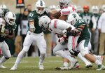 Ohio State quarterback Dwayne Haskins is sacked by Michigan State defensive end Kenny Willekes (48) during the first half of an NCAA college football game, Saturday, Nov. 10, 2018, in East Lansing, Mich. (AP Photo/Carlos Osorio)