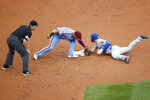 Los Angeles Dodgers' Enrique Hernandez, right, slides into second base past the tag from Philadelphia Phillies second baseman Cesar Hernandez after Hernandez hit an RBI-single during the sixth inning of a baseball game, Thursday, July 18, 2019, in Philadelphia. Hernandez advanced to second on a fielding error. (AP Photo/Matt Slocum)