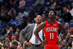 New Orleans Pelicans coach Alvin Gentry and guard Jrue Holiday watch a replay before contesting a foul  call during the first half of the team's NBA basketball game against the Phoenix Suns in New Orleans, Thursday, Dec. 5, 2019. (AP Photo/Gerald Herbert)
