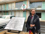 """National Civil Rights Museum President Terri Lee Freeman stands in front of the balcony of the old Lorraine Motel in Memphis, Tenn., Tuesday, Jan. 9, 2018, where Martin Luther King Jr. was fatally shot. When Dr. Martin Luther King Jr. said returning hate for hate multiplies hate, adding deeper darkness to a night devoid of stars, he wasn't thinking of the world in 2018. More than a half-century later, amid contentious political fights, one of King's memorable quotes from his book """"Strength to Love"""" remains relevant.  (AP Photo/Adrian Sainz)"""