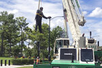 "A statue of former Carolina Panthers owner Jerry Richardson is removed from in front of the team's stadium in Charlotte, N.C., Wednesday, June 10, 2020. ""We were aware of the most recent conversation surrounding the Jerry Richardson statue and are concerned there may be attempts to take it down,"" the team said in a statement. ""We are moving the statue in the interest of public safety."" (AP Photo/Steve Reed)"