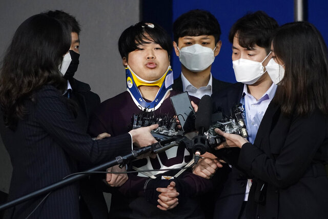 FILE - In this March 25, 2020, file photo, Cho Ju-bin, center, leader of South Korea's online sexual blackmail ring which is so called
