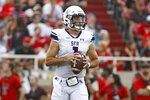 Stephen F. Austin's Trae Self drops back to pass during the first half of the team's NCAA college football game against Texas Tech, Saturday, Sept. 11, 2021, in Lubbock, Texas. (AP Photo/Brad Tollefson)