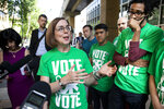 Oregon Gov. Kate Brown, running for re-election, talks with student government members at a get-out-to-vote event on the campus of Portland State University in Portland, Oregon, on Tuesday, May 15, 2018. Oregon held primaries on Tuesday. (Randy L. Rasmussen/The Oregonian-OregonLive.com via AP)