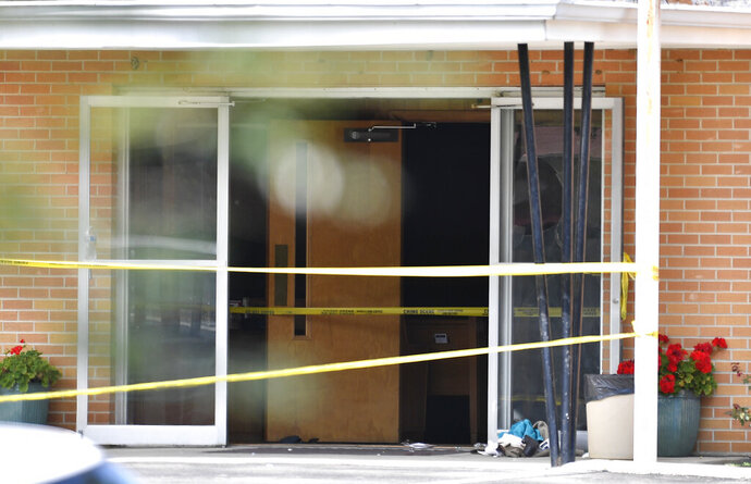 """FILE - In this Sept. 24, 2017 file photo, police tape lines the scene at the Burnette Chapel Church of Christ after a deadly shooting at the church Antioch, Tenn.  A man charged in the shooting expressed suicidal thoughts in June according to police records. With bipartisan support in many cases, 17 states and Washington D.C. have now passed so-called """"red flag laws"""" that allow the court-ordered removal of guns from people who are considered to be dangerous.(Andrew Nelles/The Tennessean via AP)"""