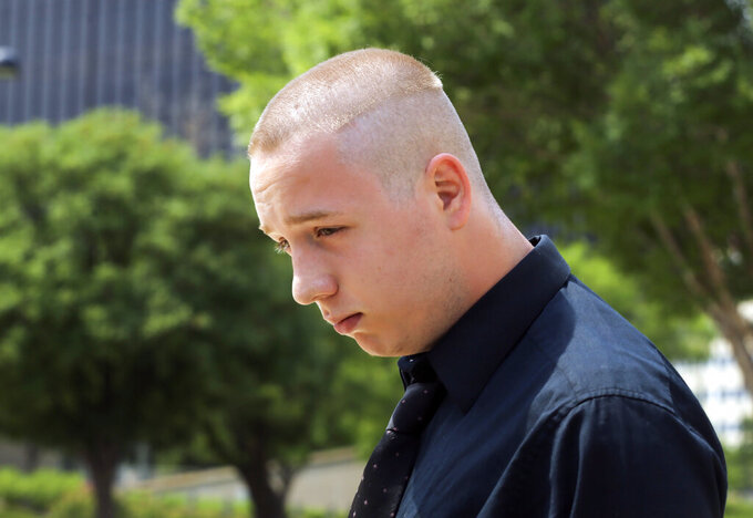 FILE - In this Wednesday, June 13, 2018, file photo, Shane Gaskill, of Wichita, Kan., leaves federal court in Wichita. Gaskill, a gamer whose online dispute with another player sparked a deadly hoax call, will have to face a jury after violating the terms of a diversion deal he made with prosecutors, a judge ruled Monday, Sept. 20, 2021. (Jaime Green/The Wichita Eagle via AP, File)